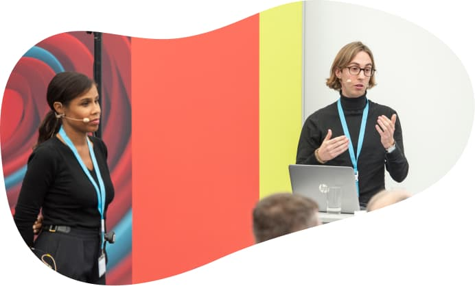Two people presenting an app to an audience.